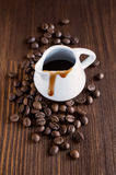 Coffee syrup with beans Royalty Free Stock Photo