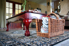 Coffee Table. Coffe table in a livingroom and magazine basket Stock Images