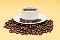 Coffee on the table. Coffee on the yellow background Royalty Free Stock Photo