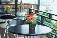 Coffee table. Artificial flowers in flowerpot on coffee table royalty free stock photos