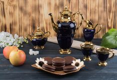 Coffee with cakes and apples Royalty Free Stock Images