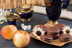 Coffee with cakes and apples Royalty Free Stock Photo