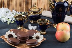 Coffee with cakes and apples Royalty Free Stock Photography