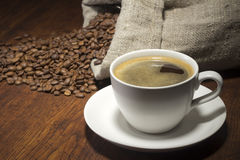 Coffee in table with a beans Royalty Free Stock Photos