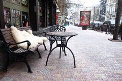 Coffee table, bench and an outdoor chair. Snowing royalty free stock images