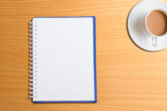 Coffee table book. Coffee and book on table Royalty Free Stock Image