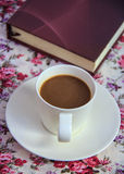 Coffee  on  table with book  and rose bouquet  fabric Stock Images