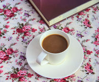 Coffee  on  table with book  and rose bouquet  fabric Stock Photo