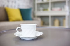 Coffee on the table. In cafe interior. Sofa pillows background Stock Photos