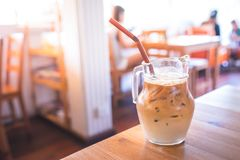 Coffee on a table in a cafe in the summer. Iced coffee on a table in a cafe in the summer stock photography
