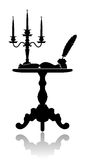 Coffee table with a candelabrum. Silhouette of a coffee table with a candelabrum, inkwell and an open book Royalty Free Stock Images