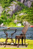 Coffee table with chair outdoor near lake Royalty Free Stock Images