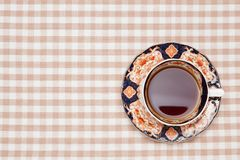 Coffee on the table cloth Stock Images