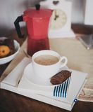Coffee on a table. Cup of coffee with milk and cinnamon standing on a table Royalty Free Stock Photo