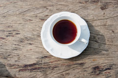Coffee on table. A coffee cup on a wooden table Royalty Free Stock Image