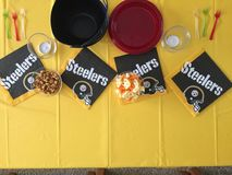 A coffee table dressed up for a football game of the NFL Pittsburg steelers Stock Photography