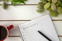 Coffee table high angle view writing diet list Stock Image