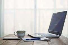 Coffee table. With laptop, smartphone and notebook stock image