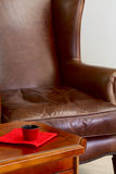 Coffee table and leather armchair Royalty Free Stock Photography