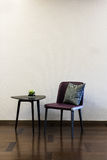 Coffee table Leather chair combination. In front of a plain wall Royalty Free Stock Images