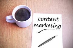 Coffee on the table with note writing content marketing Stock Photos