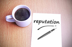 Coffee on the table with note writing reputation.  Royalty Free Stock Photography