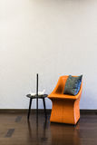 Coffee table Orange Leather chair combination. In front of a plain wall Royalty Free Stock Photography