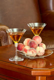 Coffee table peaches and wine Stock Photography