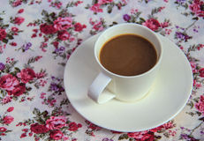 Coffee  on  table with  rose bouquet  fabric Stock Image