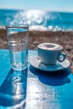 Coffee on the table on the sanny. Mourninh coffee on the beach royalty free stock image