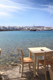 Coffee table at the sea shore. Mykonos island Royalty Free Stock Photos