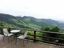 Coffee table set for two with panorama mountain scenic Royalty Free Stock Photos