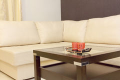 Coffee table and white corner leather sofa . Royalty Free Stock Photography