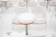 Coffee tables covered with snow. In the city Stock Image
