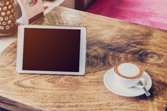 Coffee and tablet computer on table Royalty Free Stock Image