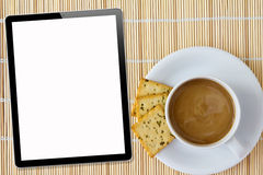 Coffee and Tablet. White porcelain cup Royalty Free Stock Photos