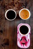 Coffee take away. Coffee cups with covers and coffee beans on wooden table backound top view copyspace Royalty Free Stock Photography