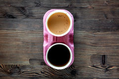 Coffee take away. Coffee cups with covers on wooden table backound top view copyspace Stock Images