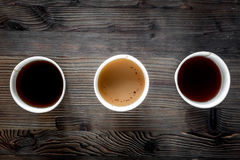 Coffee take away. Coffee cups with covers on wooden table backound top view copyspace Royalty Free Stock Image