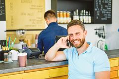 Coffee take away option for busy people. Man with smartphone order coffee. Coffee break concept. Lets meet in cafe. Man. Mobile conversation cafe barista royalty free stock photo