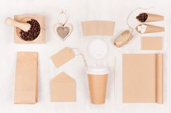 Coffee takeaway set mockup for brand - brown paper cup, blank notebook, packet, label, stationery, coffee beans, sugar, heart. Coffee takeaway set mockup for royalty free stock photo