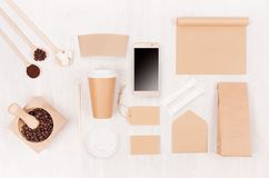 Coffee takeaway set mockup for brand - brown paper cup, blank phone, notebook, packet, label, mortar with beans, sugar on wood. royalty free stock photo