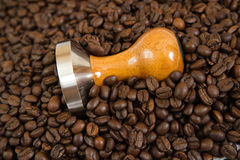 Coffee and tamper background Royalty Free Stock Images