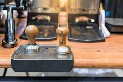 Coffee tampers, Professional coffee brewing tools from steel an royalty free stock images
