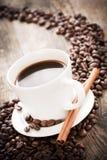 Coffee tastefully presented, next to coffee beans. Stock Photo