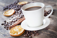 Coffee tastefully presented, next to coffee beans. Royalty Free Stock Photography