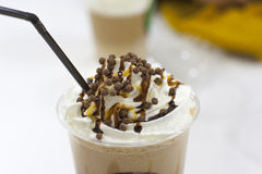 Coffee. Tasty with cream and chocolate balls royalty free stock photos