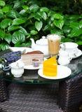 Coffee, tea, chocolate crape cake and orange cake Royalty Free Stock Images