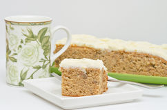 Coffee or Tea Cup with Banana Cake and one Slice Royalty Free Stock Image