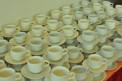 Coffee and tea cups. Cups and saucers properly arranged for the guests in a function outside the conference room Stock Images